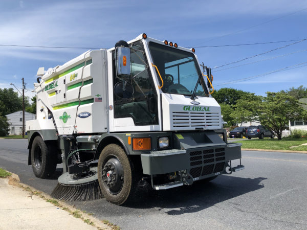 Global R4 Regenerative Air Street Sweeper in a residential neighborhood