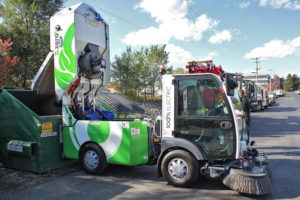 Dulevo d.zero2 Electric Street Sweeper emptying into dumpster