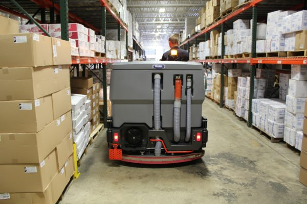 PowerBoss Nautilus Scrubber Cleaning Warehouse Aisle